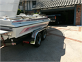 Jet ski open bow boat with dual axle trailer  All white interior with pinstripes to match exterior
