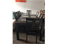 Very good condition Expresso colored dining room table Comes with six chairs and pull out leaf exte