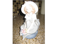 Figurine Young female with multicolored flowers in bouquet and on hat 1500 909-795-5207