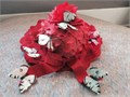 Adorable silk red rose petal hat with multicolored butterflies hovering all around it Brim is appro
