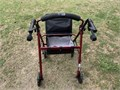 Drive walker with seat and storage bag and brakes good condition