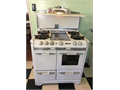 Antique gas stove w 4 burners oven broiler and storage compartment Works great and is in excell