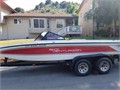 Great family ski boat   Low hours  V8 engine  Red and white open bow with tandem trailer  New up