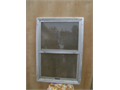 Small aluminum window 21inches wide 30Inches height lower part goes up down with a  bug screen in g