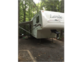 Excellent condition 2004 27 Keystone Laredo fifth wheel with a gooseneck hitch original slide hit