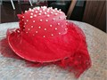 Crown is covered with individually attached white pearls Eyelet red mesh floats around the bowl F