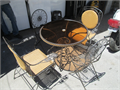 Patio table and four chairs Table has glass top chairs wrought iron and wicker Excellent conditio