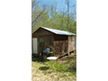 12 X 24 Hunting cabin or can be used as a storage shed Has gas heat some wiring and toilet locate