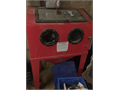 Grit blast cabinet with box of grit