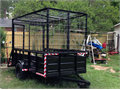 Trailer it is 5 x 10 long is has 2 foot solid sides with full wire enclosure with two full gates i