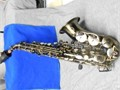 saxophone is in like new condition antique bronze mouthpiece and neck strap included