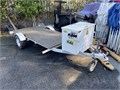 Zieman jet ski trailer converted to 4X8 utility trailer to carry dirt bikes Has storage compartment