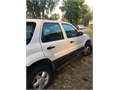 2003 Ford Escape color White one owner no accidents 240000 562-949-1210