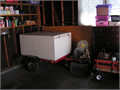 4 w x 4 d x 2 h Divided trailer  Front opens into a firewood cargo box Back opens to two