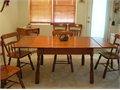 1950s Antigue Maple Table and six Chairs  Pull out leaf extension at each end  Good Condition Ma