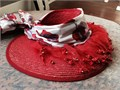 Red hat sun bonnet with printed silk scarf attached around top Scarf has red white and purple re