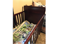 Graco crib includes mattress zoo comforter bumper pads and extra sheets  Great condition and grea