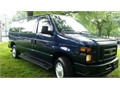 This is a blue 2008 Ford E-350 XL 12 passenger van with 52000 milesGray clot