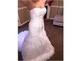 Brand new wedding dress still has tags attached Size 4  ivory in color NEVER  BEEN WORN  NO alte