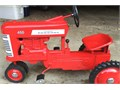 Antique Farmall 450 Peddle Tractor  Over 50 years old and completely restored like new  call or tex