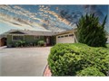 Located in a peaceful setting with breathtaking Tecolote canyon views  Spacious living areas with l