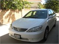 Toyota Camry sedan 2005 white color 4 doors 4 cylinder  4 new tires excellent condition sale by o