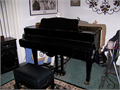 Petite black baby grand piano Carl Ebel 4ft 9in with padded bench great sound and condition 25000