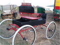 Black and Red with Grey rubber tires  Horse drawn  Craig would like 60000  Like the one in GUNSM