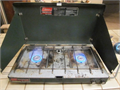 Coleman 2 burner propane stove cpmes with a full 1lb bottle of propane good condition and works per