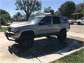 1999 Jeep Grand Cherokee 4x4 V8 w 4 Rough Country lift kit w31 tires Includes Tow package powe