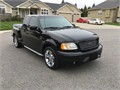 2000 Ford F150 Step Side Harley Davidson Edition Super Cab 107K original miles This truck is very