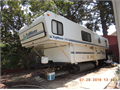 1999 Trailmanor 3023 sleeps six full bathroom 2 queen beds fold down sofa 3 burner stove with ove