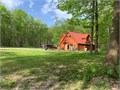 Looking to sell our home with 10 acres Newish metal roof log siding kitchen bathrooms flooring