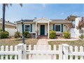 Renovated four-bedroom three-bath California Heights home with two master suites one up and one do