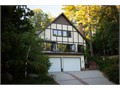 Enjoy Panoramic Views and lake rights Tudor Style upgraded 2855 sq ft home with upgraded hardwood