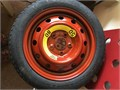This Hankook temporary Donut spare wheel  tire has been driven only 4 miles and looks like new