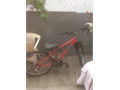 Red 5 -speed Raleigh Brand bike used in good condition comes with helmet and chain lockkeys Has