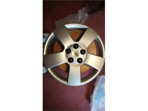 04-12 NEW GM WHEEL COVERS
