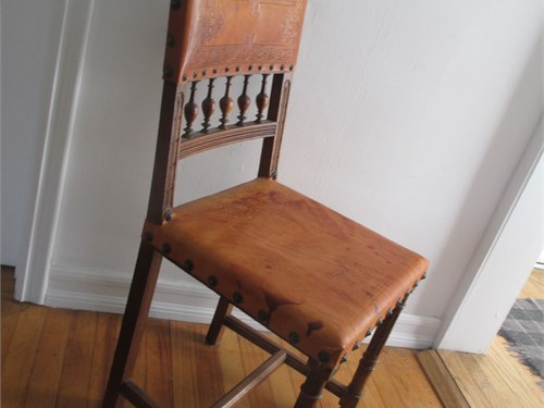 4 wood and leather chairs